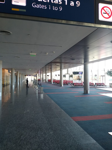 passenger waits in empty terminal at Ezeiza International Airport